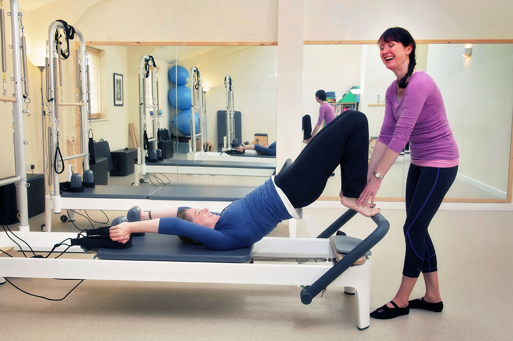 Pilates reformer equipment in use